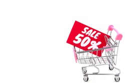 A shopping cart on wheels with a red label about discounts and sales of fifty percent in a store or supermarket