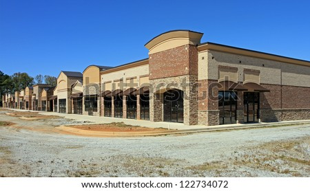 A shopping center under construction is abandoned in a poor economy.