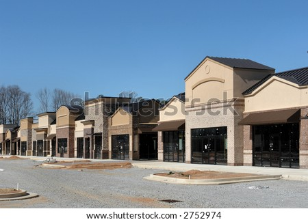 A shopping center under construction, made to appear like a small town street. - stock photo