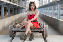A short hairs woman in red dress Santa Claus, is beautiful and smart girl in fashion festival