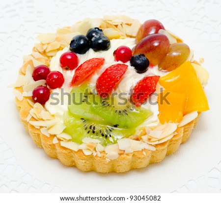 stock photo : a short pastry basket filled with cream, fruit and berries