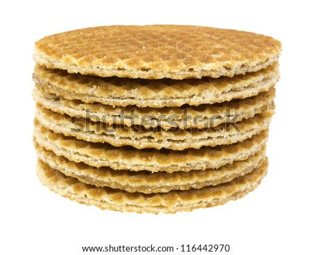 A short stack of honey filled wafer cookies on a white background.