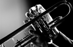 A shot close up hand play trumpet in black and white photo
