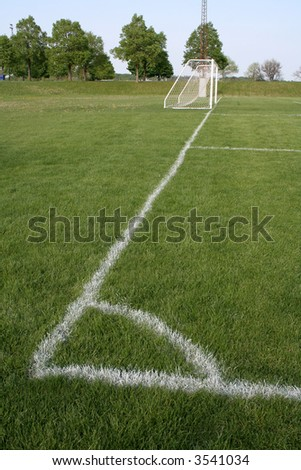 A shot from the corner kick spot on a soccer field. - stock photo