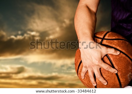 A shot of a basketball player outdoor