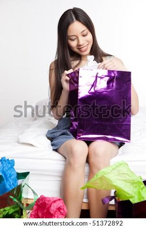 A shot of a beautiful asian girl carrying a shopping bag