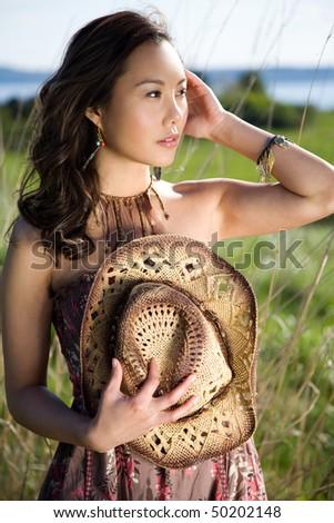 A shot of a beautiful asian girl outdoor