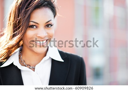 A shot of a beautiful black businesswoman outdoor - stock photo