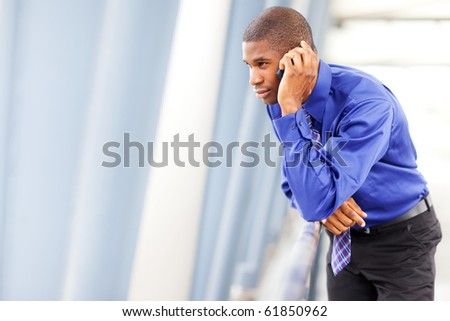A shot of a black businessman on the phone