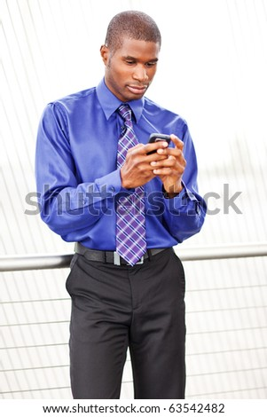 A shot of a black businessman texting