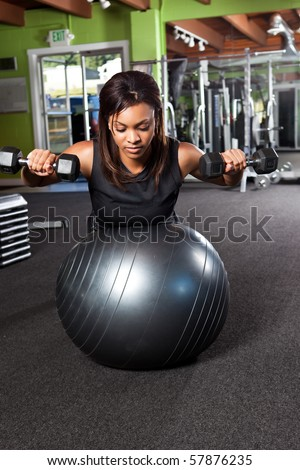 A shot of a black female athlete training and lifting weights