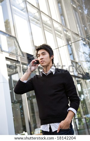 A shot of a casual asian businessman talking on the phone