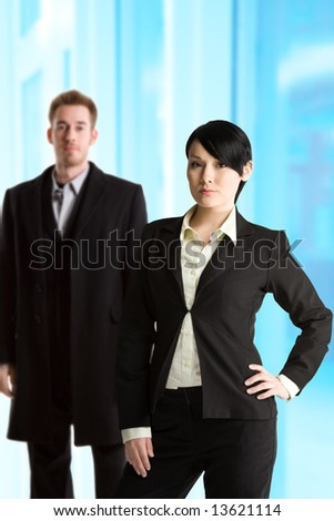 A shot of a caucasian businessman and businesswoman at the office
