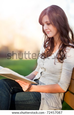 A shot of a college student reading a book