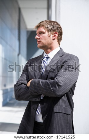 A shot of a confident caucasian businessman thinking