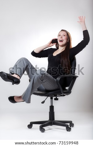 A shot of a happy caucasian businesswoman talking on the phone