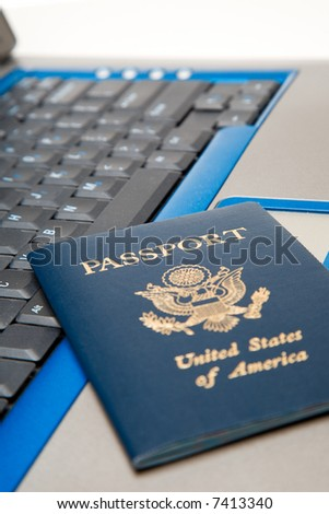 A shot of a passport and a laptop, can be used for online travel booking concept