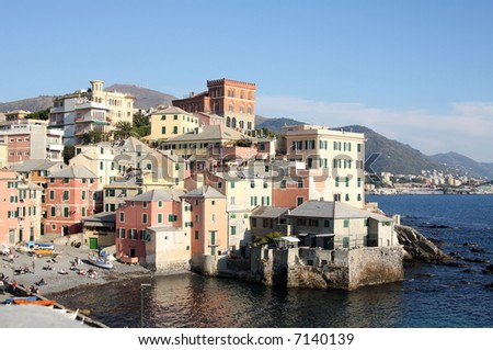 a shot of a pretty small harbour in genova, italy - stock photo
