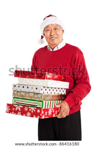 A shot of a senior Asian carrying Christmas presents celebrating Christmas