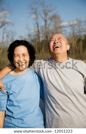 A shot of a senior couple having a good time outdoor - stock photo