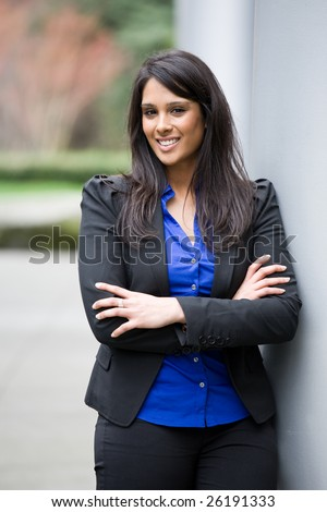 A shot of a smiling asian indian businesswoman outdoor