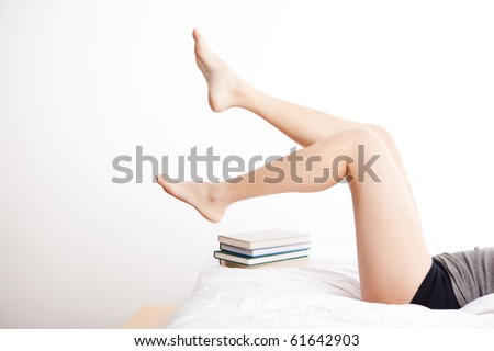A shot of a student relaxing on the bed - stock photo