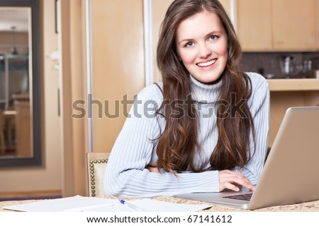 A shot of a teenage girl studying at home with laptop