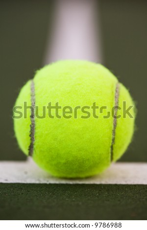 A shot of a tennis ball in the tennis court