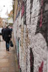A shot of a wall with graffiti looking down a street in Shoreditch in East London
