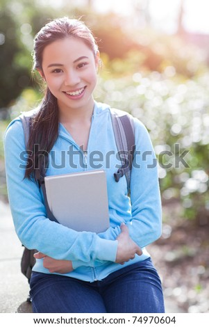 A shot of an Asian college student on campus