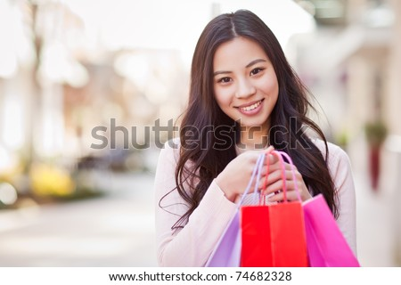 A shot of an asian woman shopping outdoor