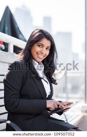 A shot of an Indian businesswoman holding a tablet PC outdoor
