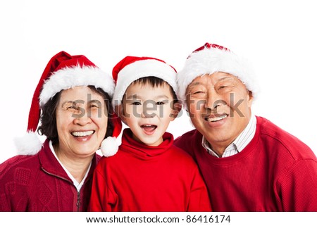 A shot of Asian grandparents celebrating Christmas with their grandson