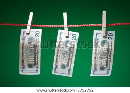 A shot of dollar bills hanging on clothesline