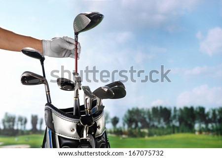 A shot of Removing golf club from bag