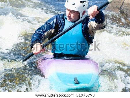 a shot of the kayaker on the rough water