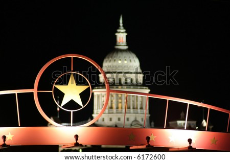 shot of the star of Texas with the Texas State Capitol Building in