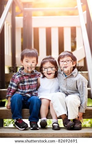 A shot of three cute little Asian kids smiling