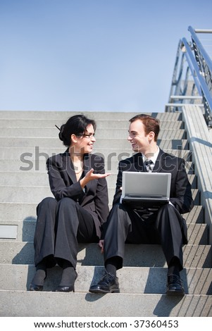 A shot of two business people having a discussion outdoor