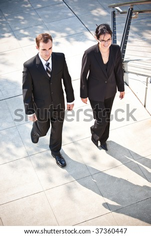 A shot of two business people walking together