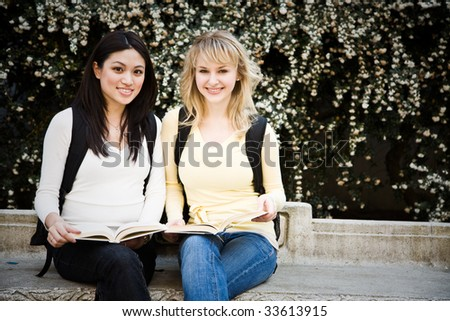 A shot of two college students having a discussion on campus