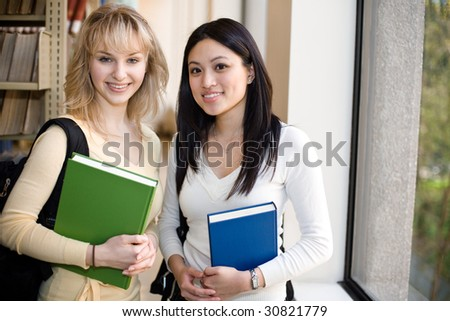 A shot of two college students in a library