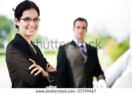 A shot of two happy business people standing outdoor