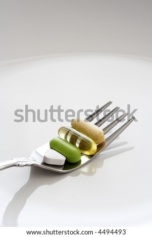 A shot of vitamin and medicines on a fork