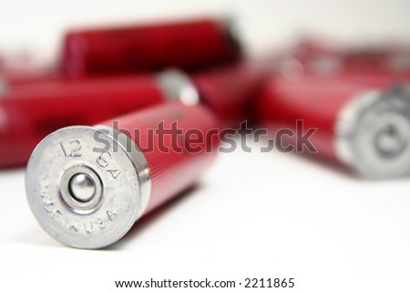 A shotgun shell stamped with made in the usa on a white background.