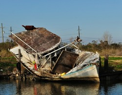 A Shrimp Trawler Boat Wrecked And Grounded On A Louisiana Bayou In The Aftermath Hurricane Katrina