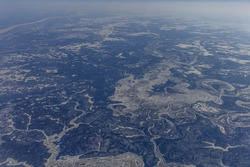 A siberian river seen from an airplane. Blue colors are magnificent. Picture was made during winter time in Russia.