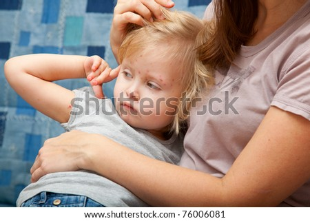A sick girl in the arms of her mother
