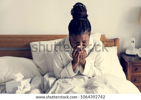 A sick woman in bed