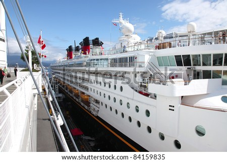A side view of a cruise ship at Canada Place in Vancouver BC Canada.